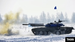 A Russian Army tank fires during a live-fire training exercise in the Kahabarovsk region on March 3.
