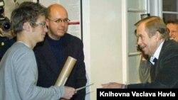 Krystof Vosatka (left) receives his award from former Czech President Vaclav Havel.