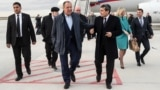 Russian Foreign Minister Sergei Lavrov (center) is welcomed by his Turkmen counterpart, Rashid Meredov (right), upon his arrival in Ashgabat on February 5.