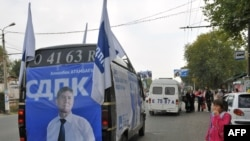 A campaign van makes its way through Osh, in southern Kyrgyzstan, on October 7.