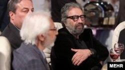 مسعود کیمیایی در کنار جمشید مشایخی در جشن روز ملی سینما در شهریور ۹۴.