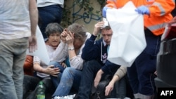 Rescue workers help victims of the Prague blast on April 29.