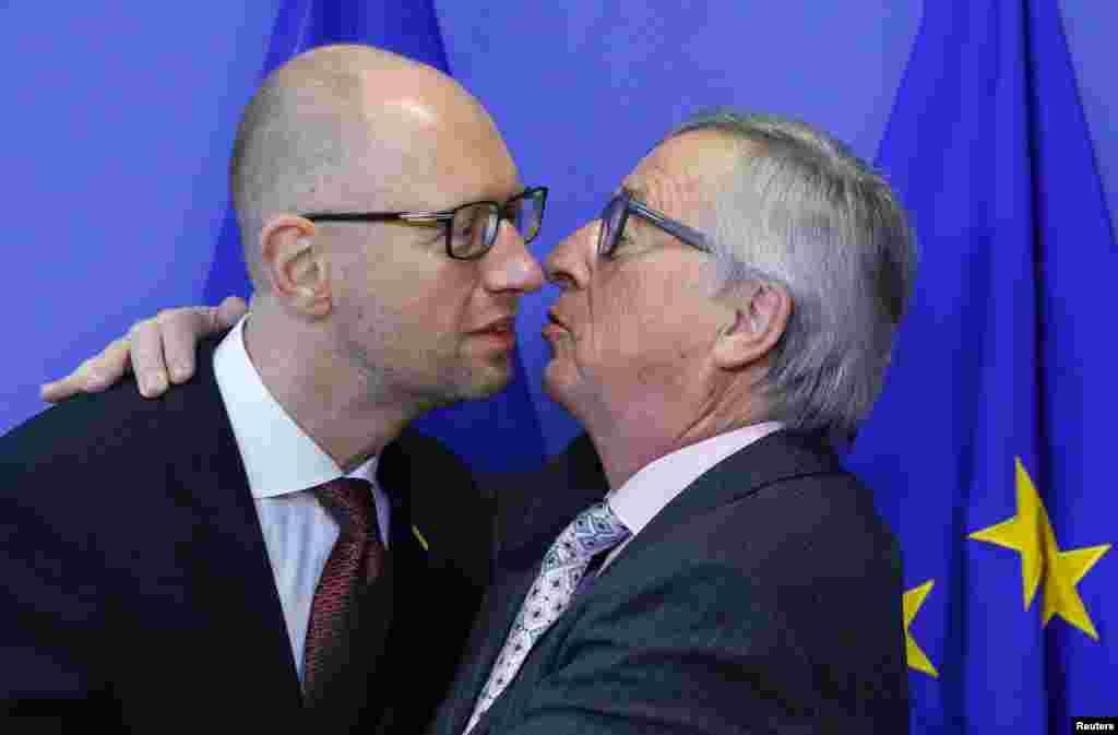Прем'єр-міністр України Арсеній Яценюк та голова Єврокомісії Жан-Клод Юнкер. Брюссель, грудень 2015 року