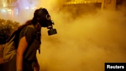 Turkey-- A protestor wears a gas mask during clashes with police near Taksim Square in Istanbul June 22, 2013