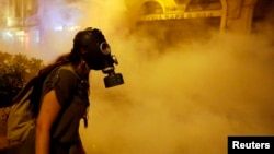 A protester wears a gas mask during clashes with police near Taksim Square in Istanbul in June.