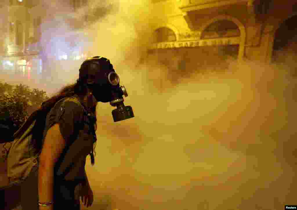 A protestor wears a gas mask during clashes with police near Taksim Square in Istanbul on the night of June 22-23. (Reuters/Marko Djurica)