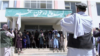 A group of Taliban fighters pose for a photo in the Zarghoo Shahr high school.
