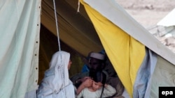 A family, displaced from Bajaur, in temporary shelter on the outskirts of Peshawar