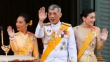 THAILAND -- Thailand's newly crowned King Maha Vajiralongkorn, Queen Suthida and Princess Bajrakitiyabha are seen at the balcony of Suddhaisavarya Prasad Hall at the Grand Palace where King grants a public audience to receive the good wishes of the people