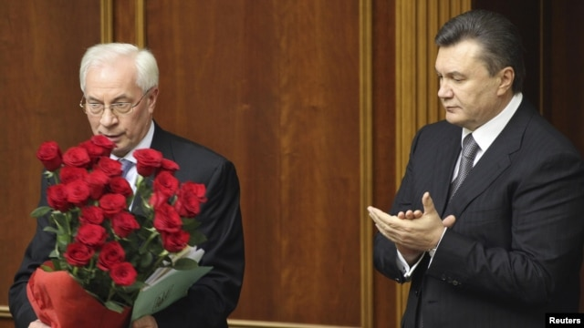 It was unclear whether President Viktor Yanukovych (right) planned to reappoint Mykola Azarov, who won a parliamentary seat in the October elections. (file photo)