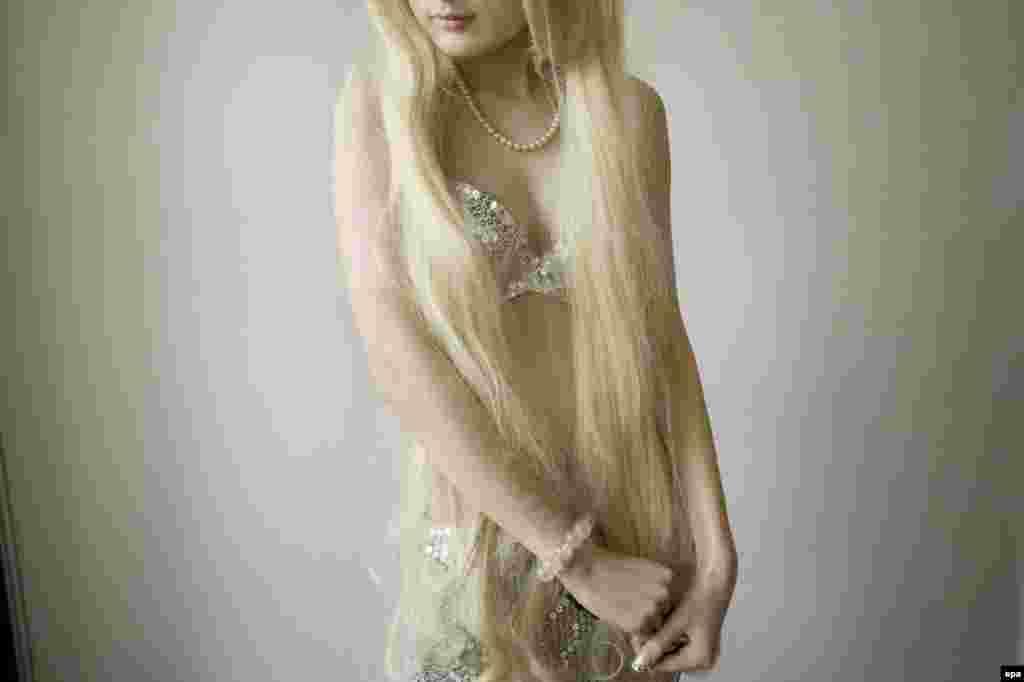 """Девушка в костюме персонажа анимэ. Шанхай. Первая премия в категории """"Искусство и развлечение"""" (одиночная фотография). Фотограф Ариана Линдсквист"""