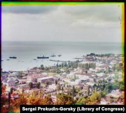 A view over Sukhumi with some steamships anchored in its harbor