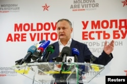 Moldova's President-elect Igor Dodon speaks to the media on November 14.