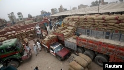 An overview of a transit depot where trucks bound for Afghanistan are loaded in Peshawar, Pakistan on September 15.