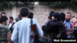 Сириядағы қазақ жиһадшылары деп жарияланған видеоның скриншоты. (Көрнекі сурет)