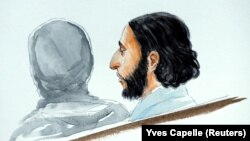 A court artist drawing shows Salah Abdeslam, one of the suspects in the 2015 Islamic State attacks in Paris, in court during his trial in Brussels in February.