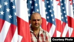 Один из задержанных - фоторепортер EPA Зураб Курцикидзе