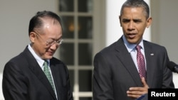 U.S. President Barack Obama (right) introduces Jim Yong Kim as his nominee to be the next president of the World Bank.