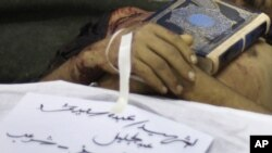 The Koran is placed on the body of an antigovernment protester, Abdou Saeed Mohammed, who was killed during recent with security forces in Sanaa.