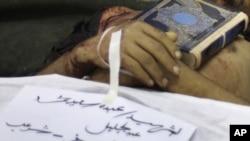 Похороны одного из погибших сторонников оппозиции