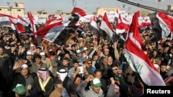Sunni Muslims take part in an antigovernment demonstration at the Sunni Umm Al-Qura Mosque in Baghdad on January 11.