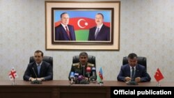 Azerbaijan - Defense Ministers Irakli Alasania (L) of Georgia, Zakir Hasanov (C) of Azerbaijan and Ismet Yilmaz of Turkey address the press after talks in Nakhichevan, 19Aug2014.