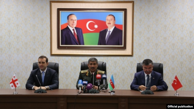 Azerbaijan - Defense Ministers Irakli Alasania (L) of Georgia, Zakir Hasanov (C) of Azerbaijan and Ismet Yilmaz of Turkey address the press after talks in Nakhichevan, 19Aug2014.