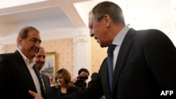 Russia -- Foreign Minister Sergei Lavrov (R) speaks with Syrian deputy Prime Minister Qadri Jamil during their meeting in Moscow, July 22, 2013