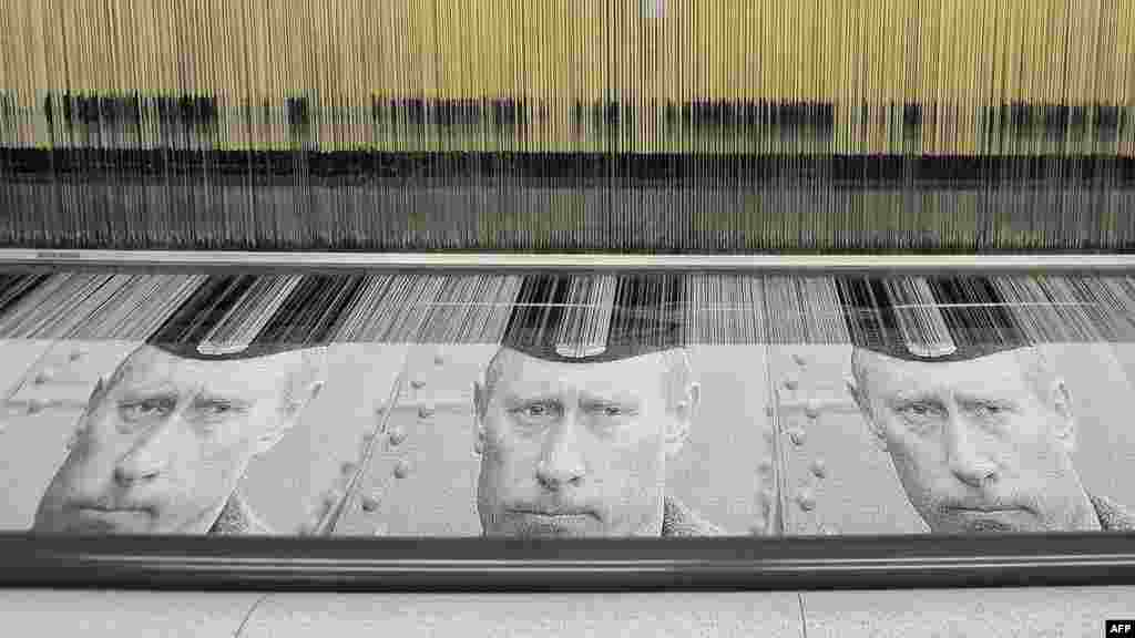 An automatic loom produces tapestries with portraits of Prime Minister Vladimir Putin at a mill in the town of Vyritsa. (AFP/Valentina Svistunova)