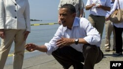 U.S. President Barack Obama inspects a Louisiana beach on May 28.