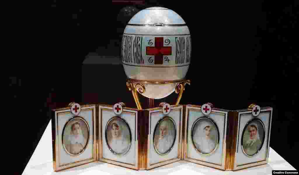 The war was a disaster for Russia, which pitted itself against a highly-industrialized Germany. After the royal palaces were converted into hospitals to tend to the wounded, the tsar's daughters served as nurses. The austere Red Cross Egg of 1915 features the portraits of the tsar's four daughters and a cousin, dressed in their Red Cross uniforms.