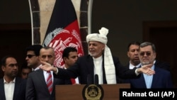 Afghan President Ashraf Ghani making a speech speaks to hundreds of after a few rockets were fired during his speech after he was sworn in at an inauguration ceremony at the presidential palace in Kabul, March 9, 2020