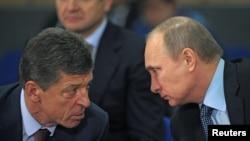 Vladimir Putin (right) speaks with Deputy Prime Minister Dmitry Kozak during preparations for the 2014 Olympic Games in Sochi.