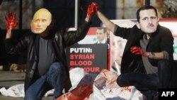 ABŞ. New York. Aktyorlar Suriya prezidenti Bashar al-Assad və Rusiyanın baş naziri Vladimir Putininin maskalarını taxaraq Suriyada baş verənlərə etiraz ediblər