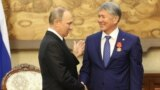 While one commenter noted that Kyrgyz President Almazbek Atambaev (right) may want to place loyalists in power after his term ends, it's not like Russia's Putin and Medvedev changing places.