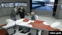 Davitashvili and Ratiani fighting in the studio.