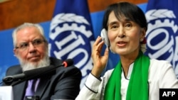 Myanmar democracy icon Aung San Suu Kyi is seen with the president of the International Labor Organization, Juan Somavia, in Geneva hours before she fell ill in Bern on June 14.