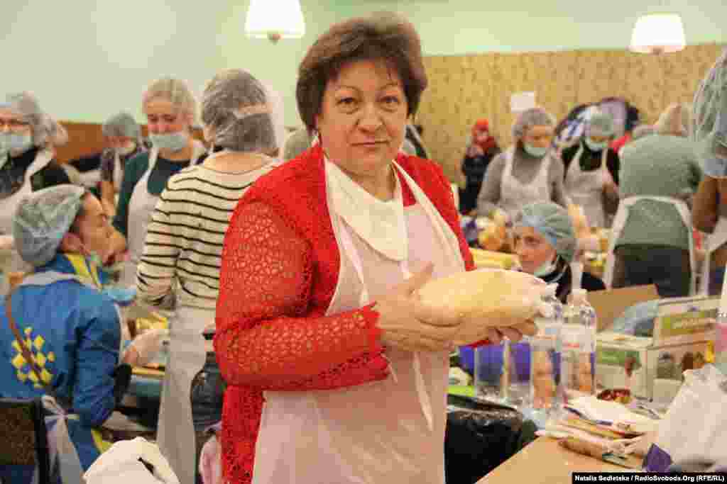 Lyubov Stepanivna, a retired sanitation inspector, checks all the food supplies to make sure no products are expired and that all the preparations meet hygienic standards.