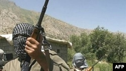 Kurdistan Workers Party (PKK) fighters patrol near the Iran-Iraq and Turkish borders.