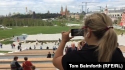A visitor takes a photo of the view of Moscow's skyline from the new Zaryadye Park on September 15.