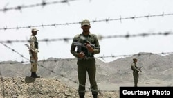 Iranian soldiers guarding the border with Pakistan.