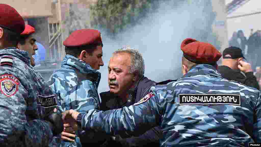 Police detain opposition parliament member Sasun Mikaelyan during an antigovernment rally in Yerevan.