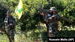 A Hezbollah fighter holds an Iranian-made anti-aircraft missile on the border with Israel, in Naqoura, April 20, 2017