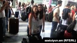 Armenia - Newly arrived Syrian Armenian children at Yerevan's Zvartnots airport, 9Aug2012.