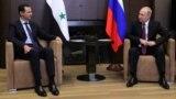 Президент Сирии Башар Асад (слева) и президент России Владимир Путин. Сочи, Россия, 17 мая 2018 года.