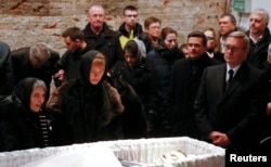 Family and friends pay their last respects during a memorial service for Nemtsov's funeral in Moscow on March 3.