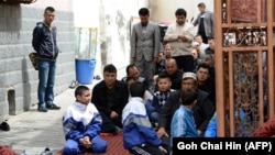 Muslim Uyghur children join the adults at a mosque for Friday Prayers in Urumqi in China's Xinjiang region.