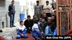 Families gather at a mosque for Friday Prayers in Urumqi, the capital of Xinjiang.