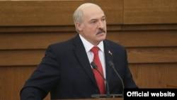 Belarusian President Alyaksandr Lukashenka addresses a session of parliament in Minsk on October 7.