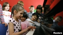 Children play music at an orphanage in the southern Russian city of Rostov-on-Don. (file photo)